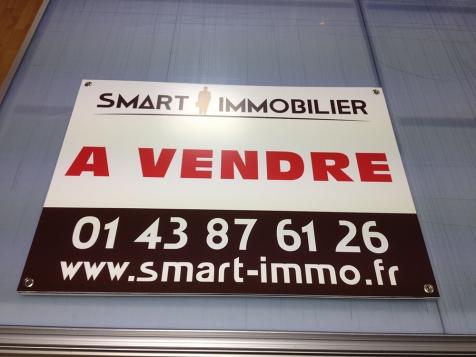 Panneaux à vendre agence Smart Immobilier à Paris